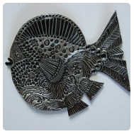 thumbnail of aluminum repousse fish