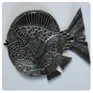 thumbnail of aluminum repousse fish